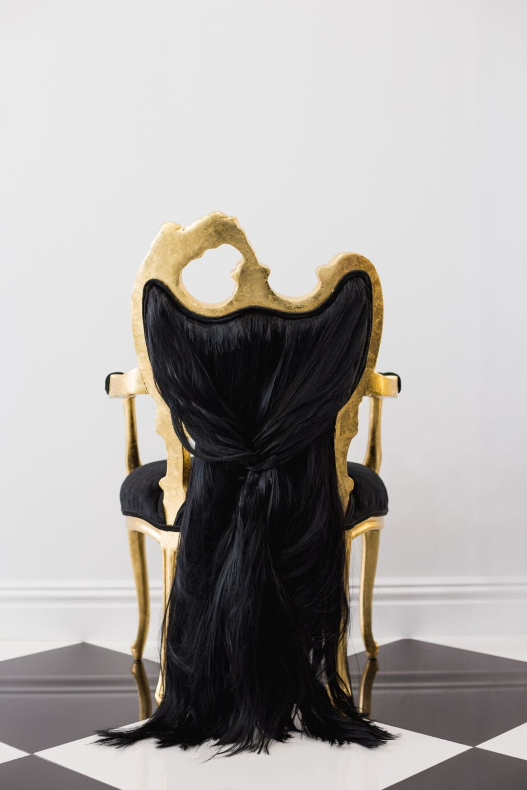 Draping black throne trimmed with gold