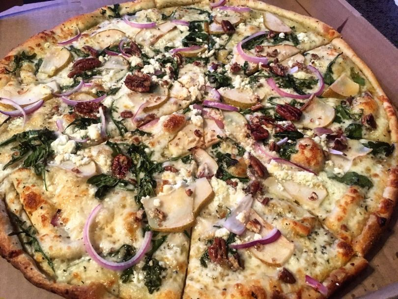 PeppeBroni's Pizza: Pear, red onion and walnut pizza with arugula and honey drizzle