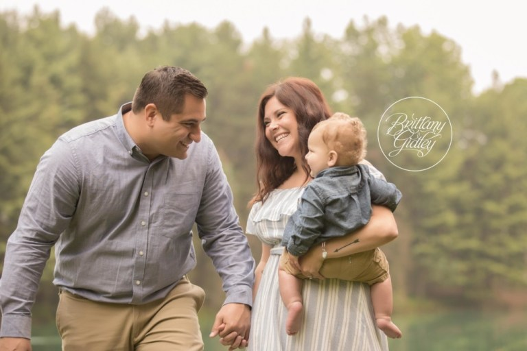 Lake Baby Photo Shoot | Medina Baby Photographer | Baby Photography | 12 Month Baby Posing With Family | Start With The Best | www.brittanygidleyphotography.com