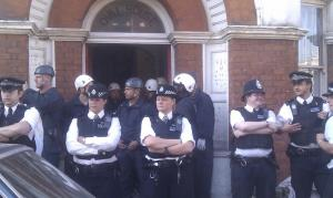 Police outside Oval House, Rushcroft Road. Picture by @Housingforthe99 on Twitter