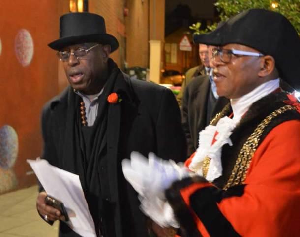 Mayor Donatus Anyanwu and Brixton BID adviser Devon Thomas sing along with the choir