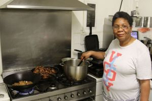 PACCA member June Thompson cooking