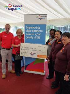 Age UK fundraiser at Lambeth Palace with cheque