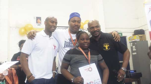 Nine year old Shanakaye at boxing awards with Tim Witherspoon and Dwaynamics coaches