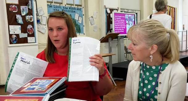 Gill Jones (right), Ofsted's deputy director of early education, looks on as year 1 senior teacher Kirsty Binnie shows examples of Hill Mead's approach