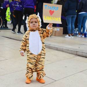 Child protester dressed as tiger