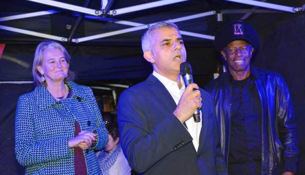 Lib Peck and Eddy Grant listen to the mayor