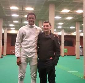 Tarriq Roache with head fencing coach Kamil Golisz