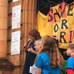 Rachel Heywood addresses the rally