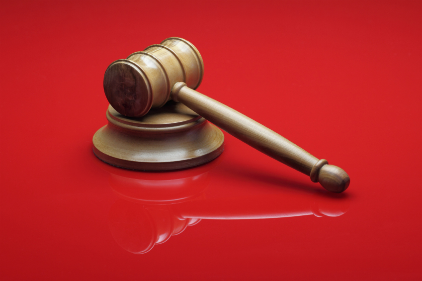 Judge's Gavel on red background