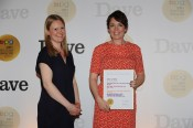 BPG chairman Emily Booth presents the Best Actress Award to Olivia Colman