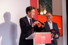 Ed Miliband and Geoff Lloyd accept the Best Podcast Award for Reasons to be Cheerful