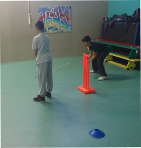 Humza  showing batting stance and Humayan showing his wicket keeping skills.
