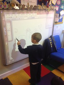 Using the interactive whiteboard to practice pencil control.