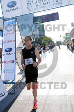 Photo of Brock crossing the finish line
