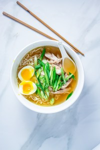 Keto Chicken Ramen In a Bowl served with soft-boiled egg and fresh green onions.