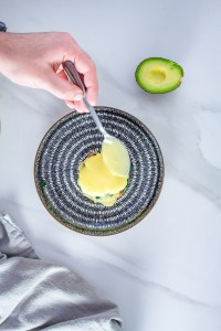 If you are looking for the Ideal Keto Breakfast Recipe, this is it. These eggs benedict are served with a creamy scoop of avocado and kale and served with a generous dollop of hollandaise sauce.