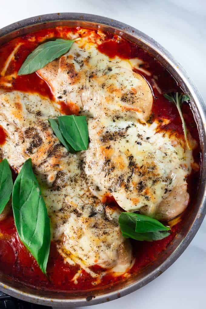 Low Carb Chicken Parmesan with Basil in a skillet