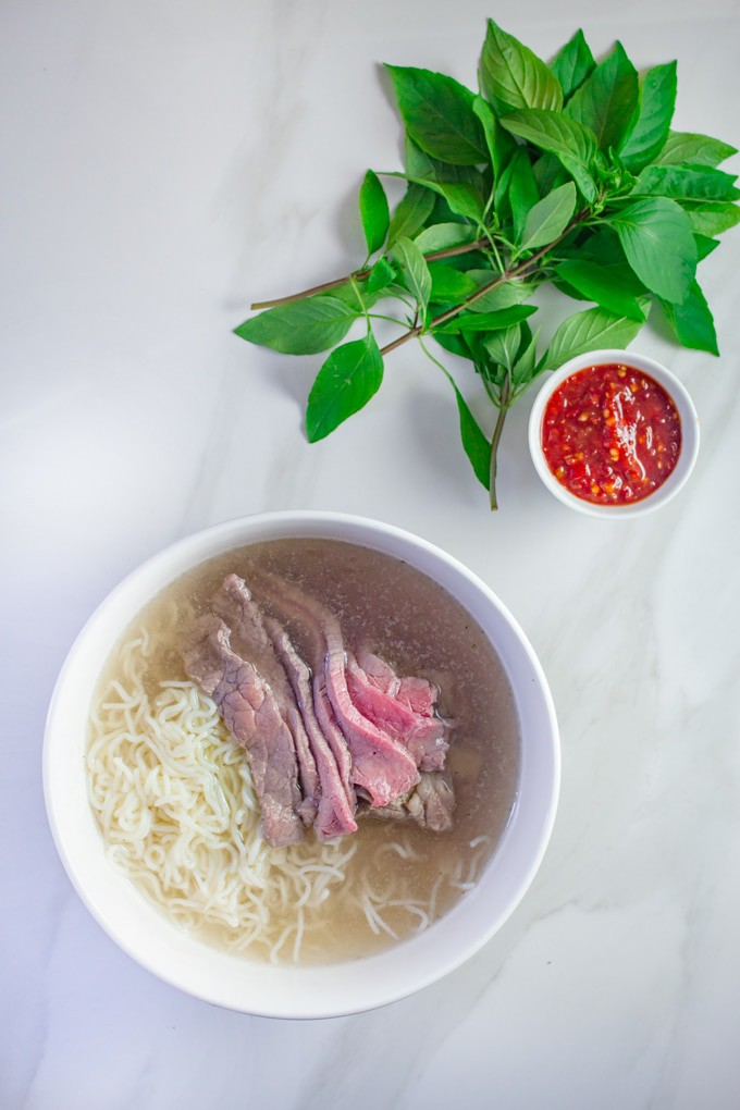 Keto Pho | Vietnamese-Style Noodle Soup | This easy keto noodle soup is made using a rich beef broth and is served with thinly sliced flank steak.