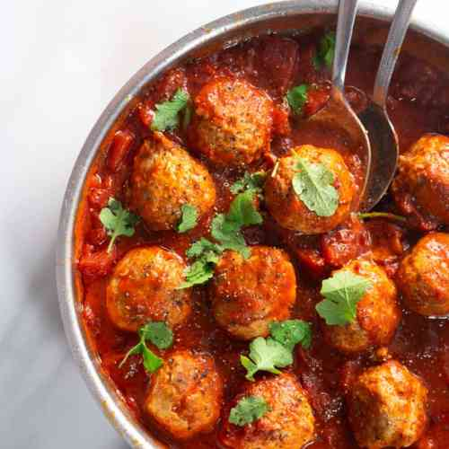Keto Chicken Meatballs served with tomato sauce