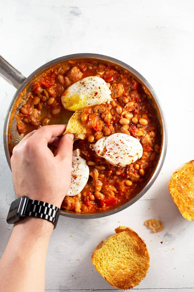 Weeknight Beans and Toast served in a skillet