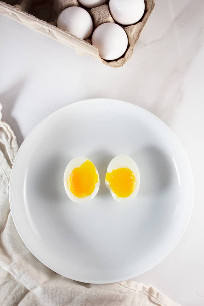 Soft boiled eggs on a white plate