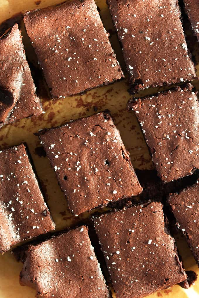 Paleo brownies cut and served with a dash of sea salt