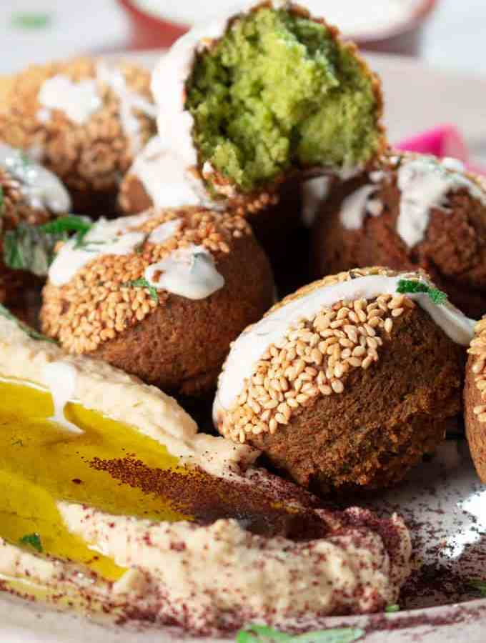 Lebanese Falafel Served on Platter with Hummus and Tahini Sauce
