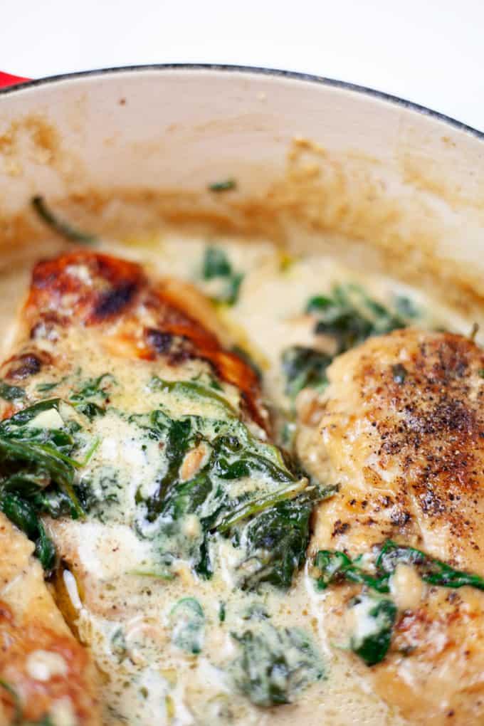 Chicken Florentine served in a deep pan.