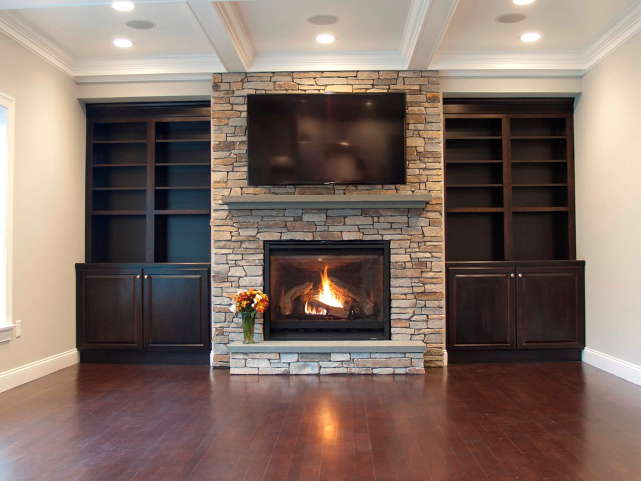oversized fireplace with builtins