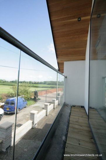 Glass balcony with unfinished decking
