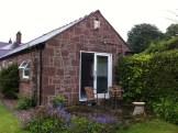 End of existing Sandstone Cottage