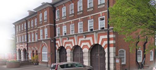three storey fire station with striking brick and stone stripes