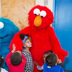 Elmo and Cookie Monster Make a Visit to the Bronx