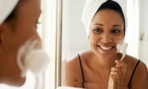woman-brushing-face