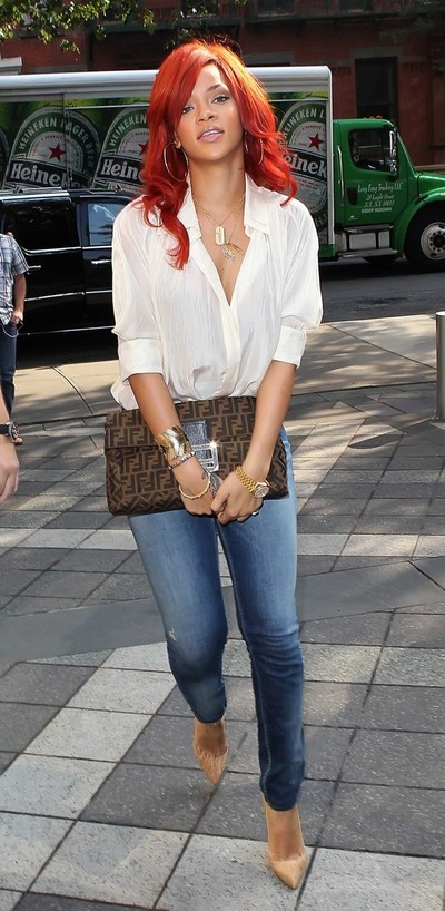 Rihanna carrying Fendi clutch bag