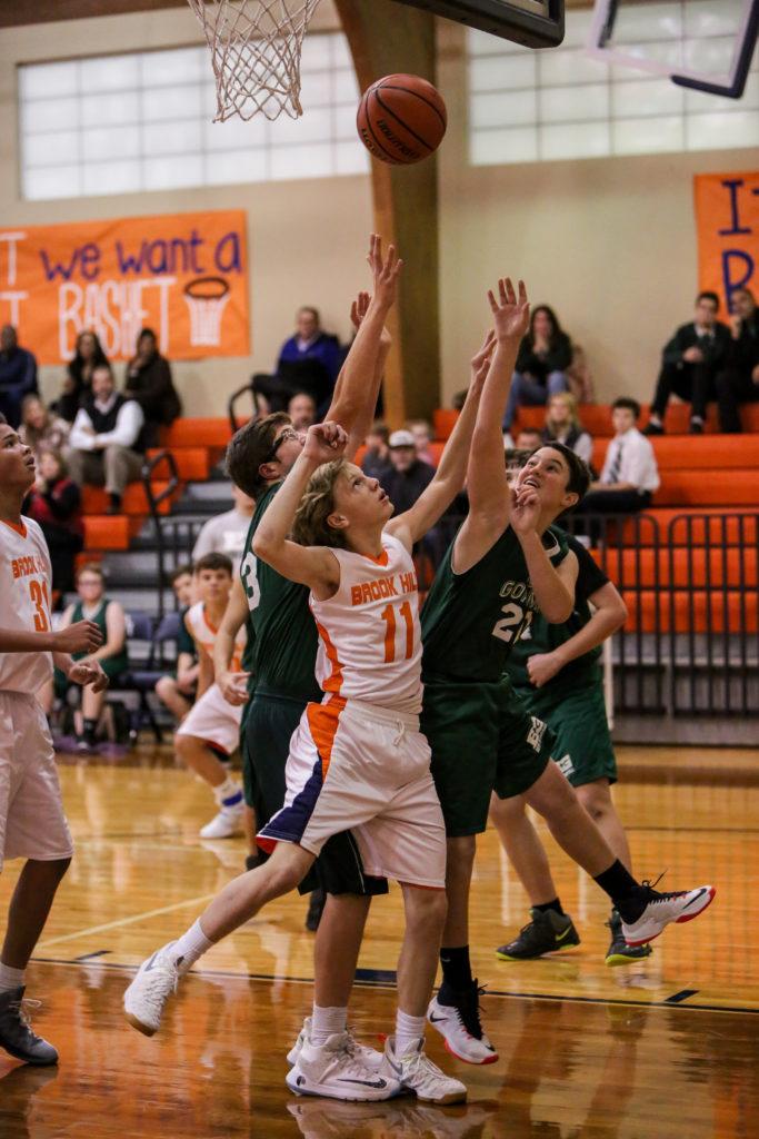 7th and 8th grade boys dribble into basketball season