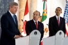 U.S. President Barack Obama and Mexico's President Felipe Calderon (C), listen to Canada's Prime Minister Stephen Harper (L) at the joint statement at the Cabanas Cultural Center in Guadalajara, Mexico, while attending the North American Leader's Summit, August 10, 2009.  REUTERS/Larry Downing (MEXICO POLITICS) - RTR26KRM
