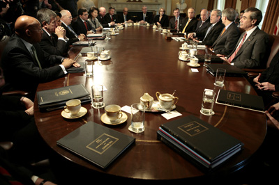 Copies of the 2008 U.S. government budget rest on a table during a cabinet meeting led by U.S. President George W. Bush (3rd R) at the White House in Washington February 5, 2007.     REUTERS/Jason Reed    (UNITED STATES)