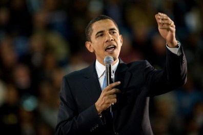 Barack Obama gestures while giving a speech.