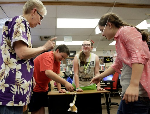 Teacher Heedum helps sixth-grade students Rosales, Weber and Heitman as they work with Boeing employees during after-school Science Technology Engineering and Math academy held at Crestwood Elementary School in Covington, Washington