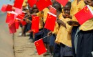 african kids waving chinese flags