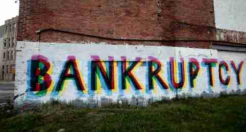 Bankruptcy graffiti on wall