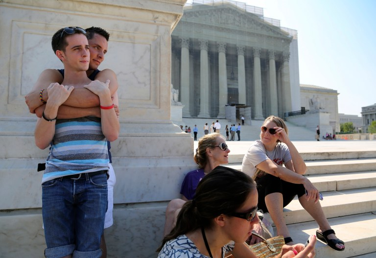 Gay couple on the steps of the Supreme Court