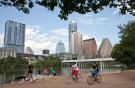 REUTERS/Julia Robinson - Cyclists pass beneath the downtown skyline on the hike and bike trail on Lady Bird Lake in Austin, Texas, September 18, 2012.