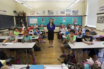 Teacher Elizabeth Moguel poses for a photograph with her seventh grade Latin class at Boston Latin School in Boston, Massachusetts September 17, 2015.