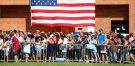 REUTERS/Aaron P. Bernstein - Supporters look on as Democratic presidential nominee Hillary Clinton campaigns with vice presidential nominee Senator Tim Kaine (D-VA) at Fort Hayes Metropolitan Education Center in Columbus, Ohio, U.S., July 31, 2016.