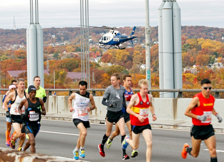 A New York Police Department helicopter watches over runners at the start of the New York City Marathon in New York, November 3, 2013. REUTERS/Adam Hunger