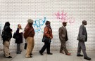 Jobseekers stand in line to attend the Dr. Martin Luther King Jr. career fair held by the New York State department of Labor in New York, U.S. on April 12, 2012.       REUTERS/Lucas Jackson/File Photo - RTX2K637