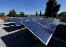 REUTERS/Mike Blake - Solar panels are shown on top of a Multifamily Affordable Solar Housing-funded (MASH) housing complex in National City, California, U.S. on November 19, 2015.